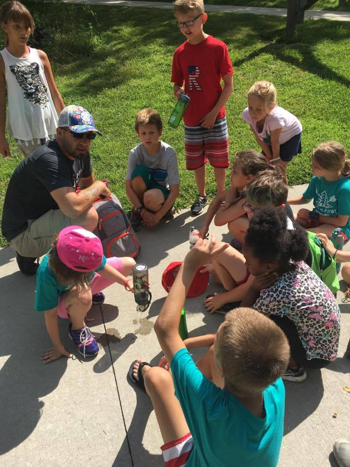 Adam Kisler leading kids in an activity at Camp Maple Woods summer day camp on July 13, 2017.